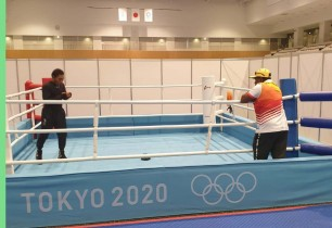 First  Athlete Arrives at Olympic Village