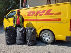 DHL assists Team PNG with courier of Team's uniform