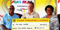 Trukai presents funds to PNGOC