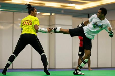 Maxemillion executing a side kick to Samantha during training in Rio. PHOTO: J. Pini/ Team PNG.