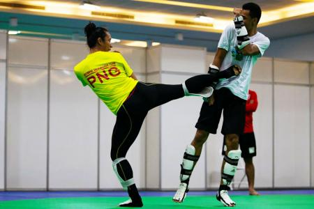 Samantha Kassman puts Maxemillion's defense to the test during training in Rio. PHOTO: J. Pini/ Team PNG.