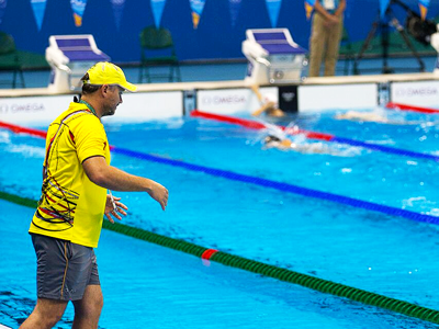 POOLSIDE: Ryan Pini pops his head up for a word with his coach, Robert Van der Zant during training in Rio. PHOTO: J. Pini/ Team PNG.