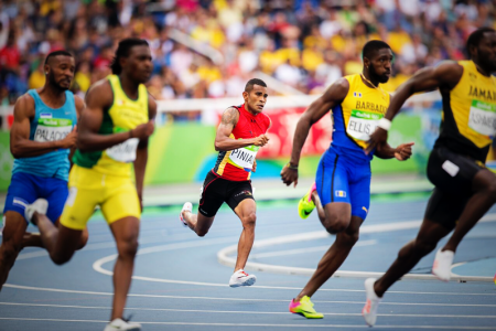 BIG FIELD: Theo Piniau pressing up to his field of competitors in the men's 200m heat. PHOTO: J. Pini/ Team PNG.