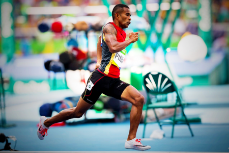 IN STRIDE: Theo Piniau coming round the 100m bend in his 200m heat. PHOTO: J. Pini/ Team PNG.