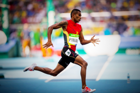 FULL SPEED: Theo Piniau heading to the finish line in the men's 200m heat. PHOTO: J. Pini/ Team PNG.