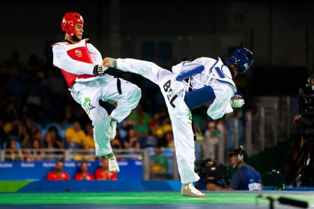 IN THE AIR: Max tries to counter a kick from his opponent. PHOTO: J. Pini/ Team PNG.