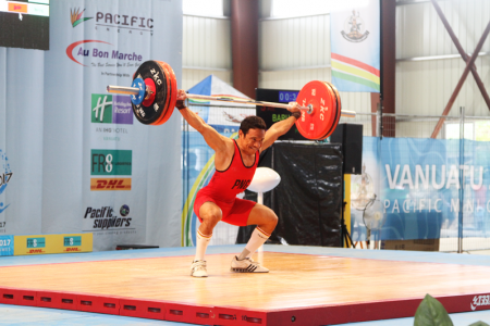 Morea Baru using his leges to power up the lift in the snatch competition.