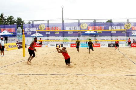 PNG's Moha Mea and Richard Kilarupa taking on Solomon Islands in their first match of the tournament.